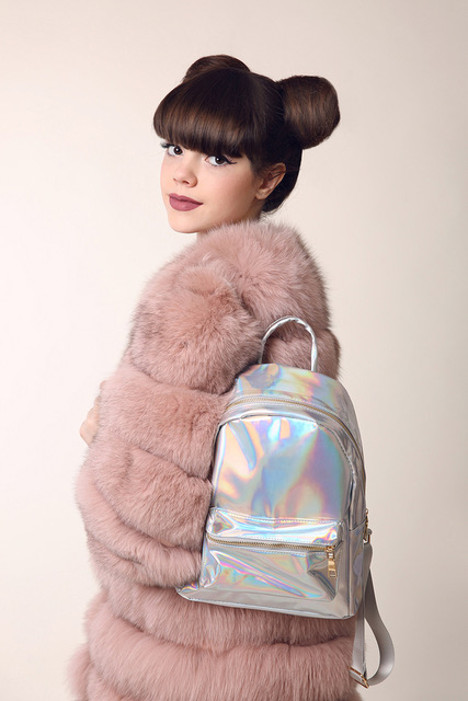 teen with metallic silver backpack