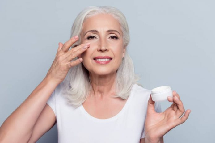 lady wearing mario badescu eye cream
